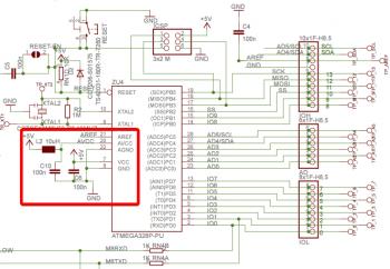 Schemat Arduino UNO z zaznaczoną sekcją zasilania, w której znajduje się dławik